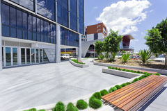 Forecourt of Modern Corporate Building. With bench Royalty Free Stock Image