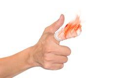 Forefinger при пламя и повязка изолированные на белой предпосылке стоковая фотография