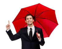 Forefinger gesturing man with opened red umbrella Stock Images