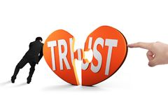 Forefinger and man push heart puzzle pieces with TRUST together Royalty Free Stock Images