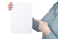Forefinger points on blank paper in female hand Stock Images