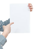 Forefinger points on sheet of paper Stock Image