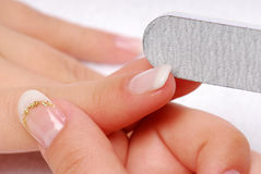 Forefinger - polishing nail Stock Photos