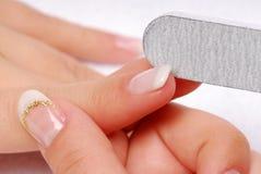 Forefinger - polishing nail Stock Photos