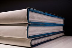 Forefront of a group of books stacked. Forefront of a group of white books stacked royalty free stock images