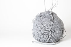 Yarn wool and knitting needles. Foreground of ball of wool with  knitting needles detail Stock Photo