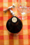 Foreground of bottle of wine in 2012. Foreground of opening a bottle of red wine of 2012 Stock Photography