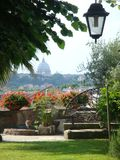 Foreground of a city garden with after all the dome of the Basilica of St. Peter of Rome Italy. Royalty Free Stock Photography