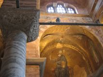 Foreground of the extremity of a marble column of the church of St. Savior in Chora to Istanbul with a mosaic of the Christ. royalty free stock photos