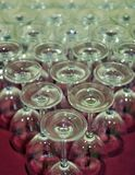 Foreground of glasses for wine in a bar. Exhibitor in a Spanish restaurant with many clean beer glasses Royalty Free Stock Images