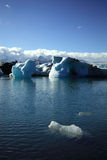 Foreground iceberg. A small iceberg in the foreground Jokulsarlon lagoon Iceland Royalty Free Stock Image