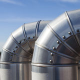 Silvered Pipeline. Foreground of  and Industrial air conditioning and ventilation system. Square format Stock Photography