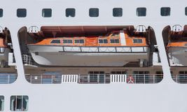 Foreground of an orange lifeboat Royalty Free Stock Photography