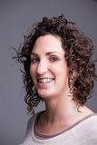 Foreground portrait of a smiling curly haired woman Stock Photo