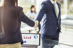 Shaking hands with financial partners near the workplace Royalty Free Stock Photo