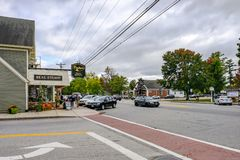 Exterior view of an empty side street junction showing a timber-built Real Estate building together with a parking lot at a road royalty free stock photography