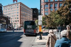 Tour bus seen parked in Boston, MA, waiting for tourists to board. Royalty Free Stock Image