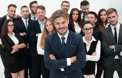 Smiling businessman standing on background of her business team. Royalty Free Stock Photo