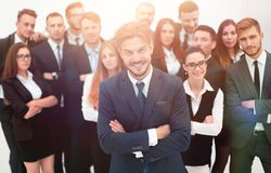 Smiling businessman standing on background of her business team. Stock Photo