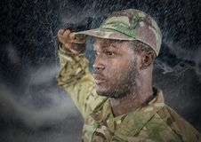 Foreground of soldier saluting in the storm. Stock Photos