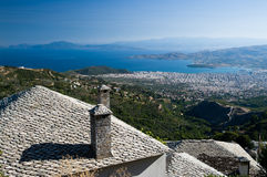 Foreground stone roof and background bay. Foreground on traditional stone roof of Makrinitsa in background city of Volos on gulf of Pagassitikos, Greece Stock Photo