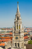 In the foreground the tower of the New Town Hall is a town hall at the northern part of Marienplatz. In Munich, Bavaria, Germany Stock Photos