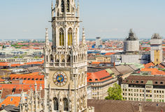 In the foreground the tower of the New Town Hall is a town hall at the northern part of Marienplatz. In Munich, Bavaria, Germany Royalty Free Stock Photos