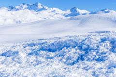 In the foreground trace avalanche. Close up of snow clods on the track of the avalanche in the mountains Stock Image