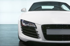 Foreground of white sportcar  at exhibition Royalty Free Stock Photo