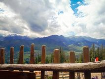 In the foreground a wooden fence and in the background the Tatra mountains. View from Gubalowka Royalty Free Stock Photography