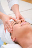 Forehead massage Stock Photo