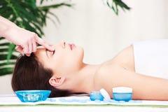 Forehead massage Stock Photos