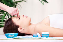 Forehead massage treatment in spa salon Stock Image