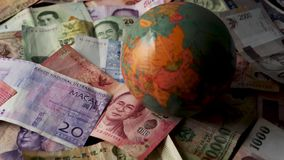 Foreign Banknotes Credit Spinning Globe International Finance World Currency. 4K UHD footage of FHD 59.94FPS footage of Foreign Banknotes Spinning Globe stock video