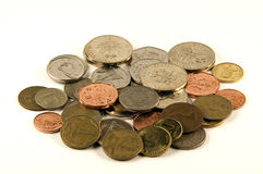 Foreign Coins. A pile of foreign coins on a white background Royalty Free Stock Photography