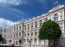 Foreign and Commonwealth Office London England. The facade of the Foreign and Commonwealth Office building with an english flag at Whitehall, London, England Royalty Free Stock Photography