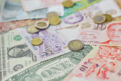 Foreign currency. A photo showing various foreign currencies including notes and coins Stock Image