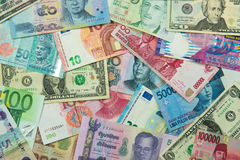 Foreign currency banknotes. Close up of foreign currency banknotes forming background Royalty Free Stock Photos