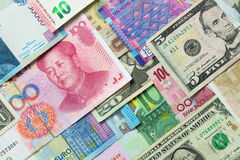 Foreign currency banknotes. Close up of foreign currency banknotes forming background Stock Photography