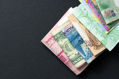 Foreign currency banknotes. Over black background Stock Photography