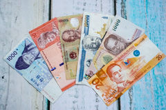 Foreign currency banknotes. On wooden floor Stock Image