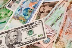 Foreign currency bills. Pile of foreign currency bills stock image