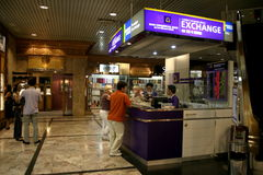 Foreign currency exchange. Tourists changing money. Foreign currency exchange counter at CentralWorld, Bangkok, Thailand royalty free stock images