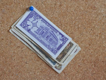 Foreign currency on a peg board. Some foreign currency pinned to a peg board stock image