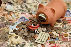 Foreign Currency and Piggy Bank Royalty Free Stock Photos