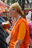 Foreign devote in India. March 08,2012 Mayapur,Nadia,West Bengal,India,Asia- A foreign devotee drinking coconut water at outside of the ISKCON temple Royalty Free Stock Image
