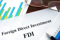 Foreign direct investment FDI form on a table. Business concept stock images