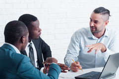 Foreign employees training and studying in office. New employees studying. Great chance for foreign workers. Interracial cooperation about training specialists royalty free stock image