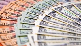 Foreign exchange. US banknotes on a fan of high-denomination european euro notes Stock Photos