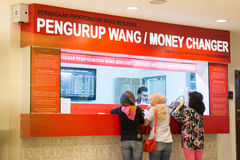 Foreign exchange counter in Malaysia. KUALA LUMPUR - February 6, 2015: World oil price slump has caused the Malaysian Ringgit depreciated further against the US Royalty Free Stock Images